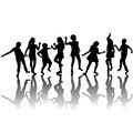 Group of children silhouettes dancing black Royalty Free Stock Image