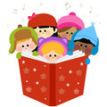 Group of children singing Christmas carols.
