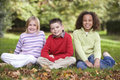Group of children sitting in garden Stock Photography