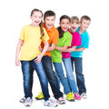 Group of children stand behind each other happy in colorful t shirts on white background Stock Images