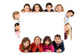Group of children with a white board isolated in white Stock Photo