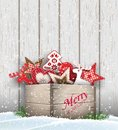 Group of Christmas ornaments in old wooden box Royalty Free Stock Photo