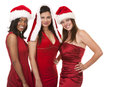Group of christmas women beautiful three holding presents on white background Stock Image