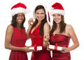 Group of christmas women beautiful three holding presents on white background Stock Photos