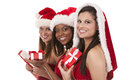 Group of christmas women beautiful three holding presents on white background Stock Photo