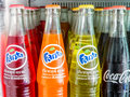 Group of Coca-Cola and Fanta Bottles on shelf in refrigerator Royalty Free Stock Photo
