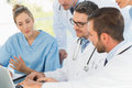 Group of concentrated doctors using laptop together at the medical office Royalty Free Stock Image