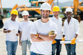Group of construction workers happy at a building site Royalty Free Stock Images