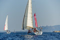 Group of cruising sailboats is sailing in the Mediterranean sea. Royalty Free Stock Photo