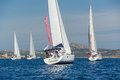 Group of cruising sailboats is sailing near the Sardinia island. Royalty Free Stock Photo