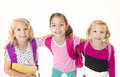 Group of cute little girls going to school three young isolated on a white background Stock Photo