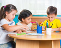 Group of cute little prescool kids drawing with colorful pencils Stock Images