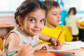 Group of cute little prescool kids drawing with colorful pencils Royalty Free Stock Image