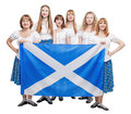 Group of dancers of Scottish dance with Scotland flag Royalty Free Stock Photo