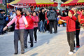 Group dancing on the square a of senior women exercise in public by line pangan nanchong china Royalty Free Stock Photography