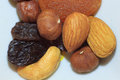Group of delicious nuts, raisins and dried apricots. Royalty Free Stock Photo