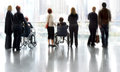 Group and disabled people in the lobby business center Royalty Free Stock Photo