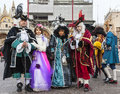 Group of disguised people venice carnival italy march posing in san marco square during the days Stock Photography