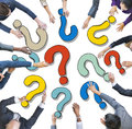 Group of Diverse Business People with Question Marks Royalty Free Stock Photo