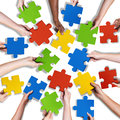 Group of Diverse Hands Holding Jigsaw Puzzle Royalty Free Stock Photo