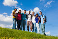 Group of diverse students friends outside a college on a hill with a sky background Stock Photo