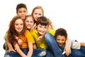 Group diversity looking kids boys girls sitting floor hugging laughing Royalty Free Stock Images