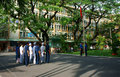 Group of doctor trooping the colour in hospital ho chi minh city vietnam may and nurse standing with solemn spirit toward flagpole Royalty Free Stock Images