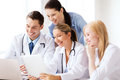 Group of doctors looking at tablet pc healthcare medical and technology concept Stock Photos