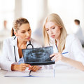 Group of doctors looking at x-ray Stock Image