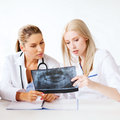 Group of doctors looking at x ray healthcare medical and radiology concept Stock Images