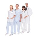 Group of doctors standing in row happy over white background Royalty Free Stock Photo