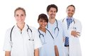 Group of doctors standing together over white isolated background Stock Photography