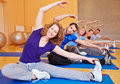 Group doing stretching exercises Stock Images