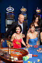 Group of elegant people playing roulette Royalty Free Stock Photo
