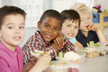 Group Of Elementary Age Schoolchildren Eating Healthy Packed Lunch In Class Royalty Free Stock Photo
