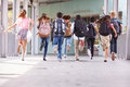 Group of elementary school kids running at school, back view Royalty Free Stock Photo