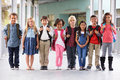 Group of elementary school kids standing in school corridor Royalty Free Stock Photo