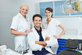 Group of employees at dentist happy with two dental assistants Stock Images