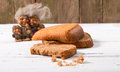 The group of fantastic beings brownie looks at a piece of brea bread against old gray boards bread rye close up small depth Stock Photos