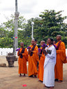 Group of female buddhist monks in sri lanka make a merit inside the temple Stock Photo