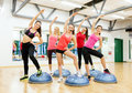 Group of female doing aerobics with half ball fitness sport training gym and lifestyle concept smiling Stock Image