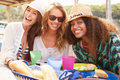 Group Of Female Friends Enjoying Lunch Outdoors Royalty Free Stock Photo