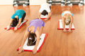 Group in fitness club relaxing and stretching Royalty Free Stock Images