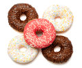 Group of five assorted donuts in white pink and chocolate brown coatings and sprinkles on white background Stock Photos