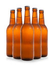 A group of five beer bottles in a diamond formation on white bac Royalty Free Stock Photo