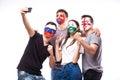 Group of football fans their national team: Slovakia, Wales, Russia, England take selfie