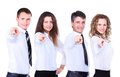 Group of four business people in a row pointing Royalty Free Stock Photo