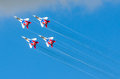 A group of four fighter aircraft in the blue sky with smoke. Russia. Moscow August 2015