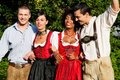 Group of four friends in Bavarian Tracht Royalty Free Stock Photo