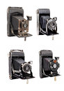 Group of four photocamera on medium format with bellows isolated built in the last century Stock Image